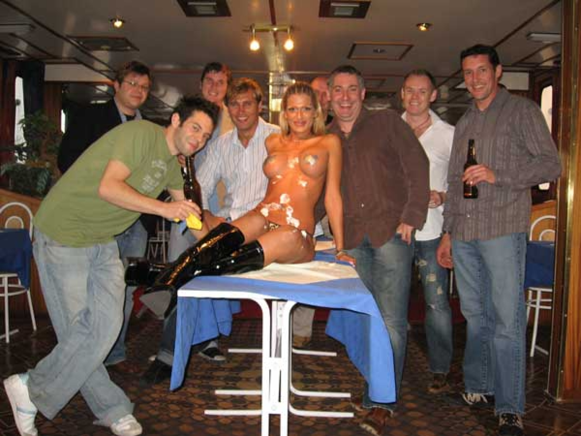 Lads group with desert girl covered in cream