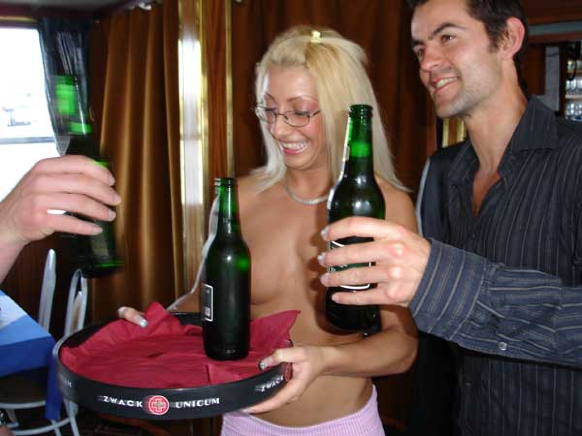 Topless hostess with Beer