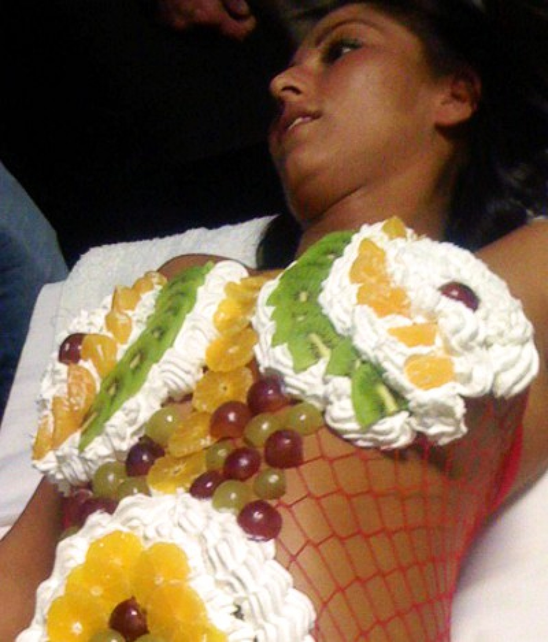 girl covered in fruit salad
