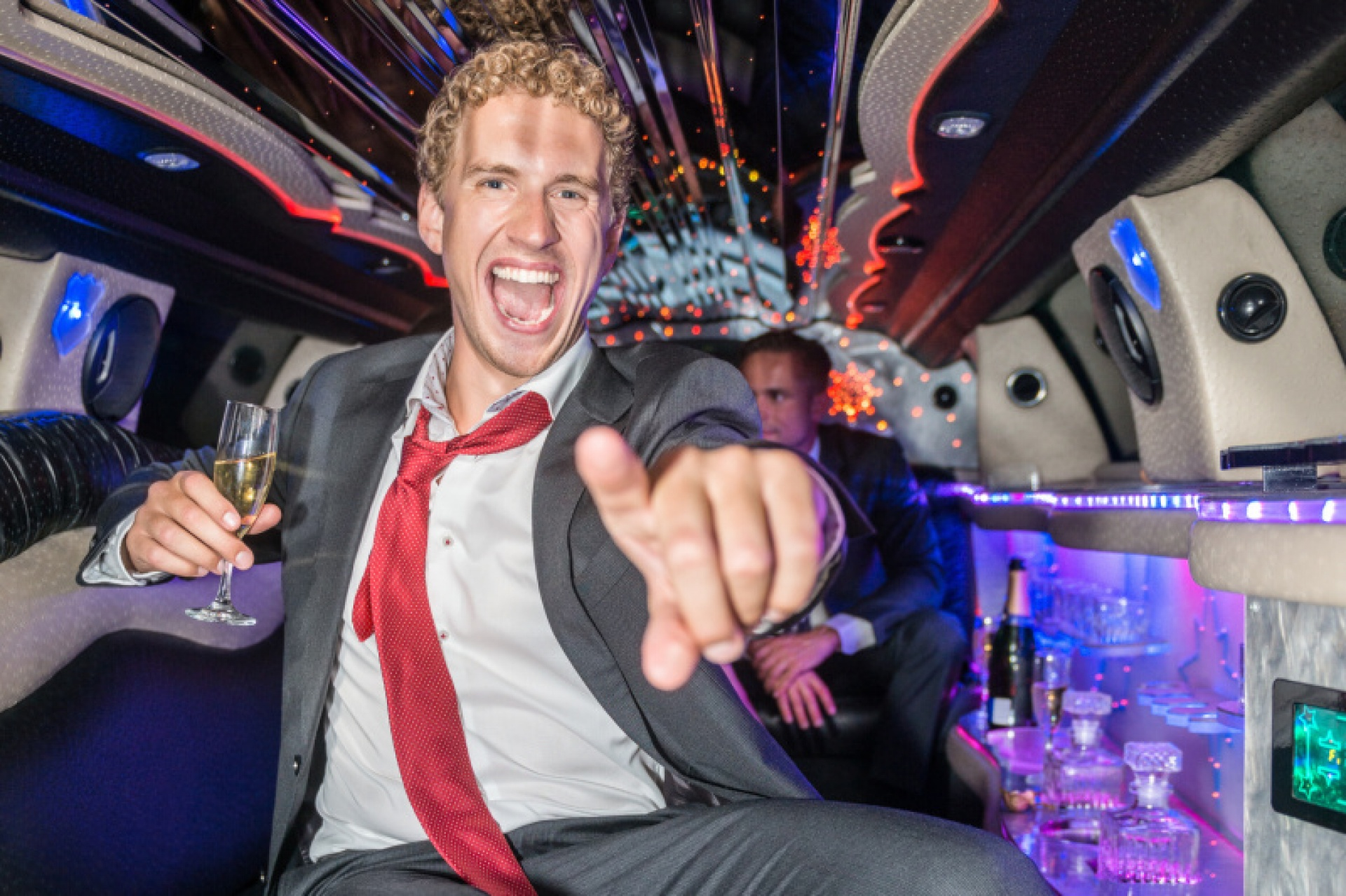 man partying in a limousine