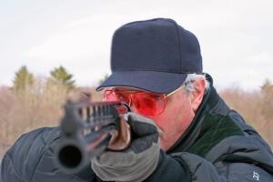 man pointing shot gun at you