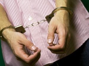 Mans hands in handcuffs