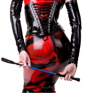 girl in PVC with a whip