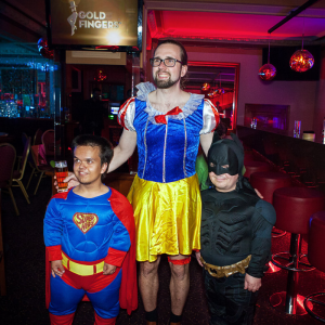 a man and two dwarfs in costumes