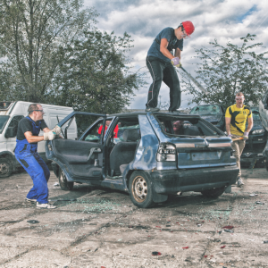 men destroying a car
