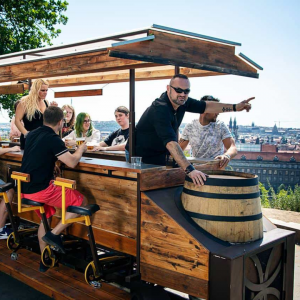 people on a beer bike