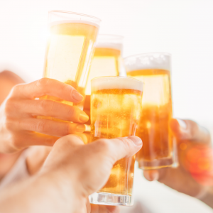 hands toasting with beers
