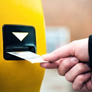 hand validating Prague public transport ticket