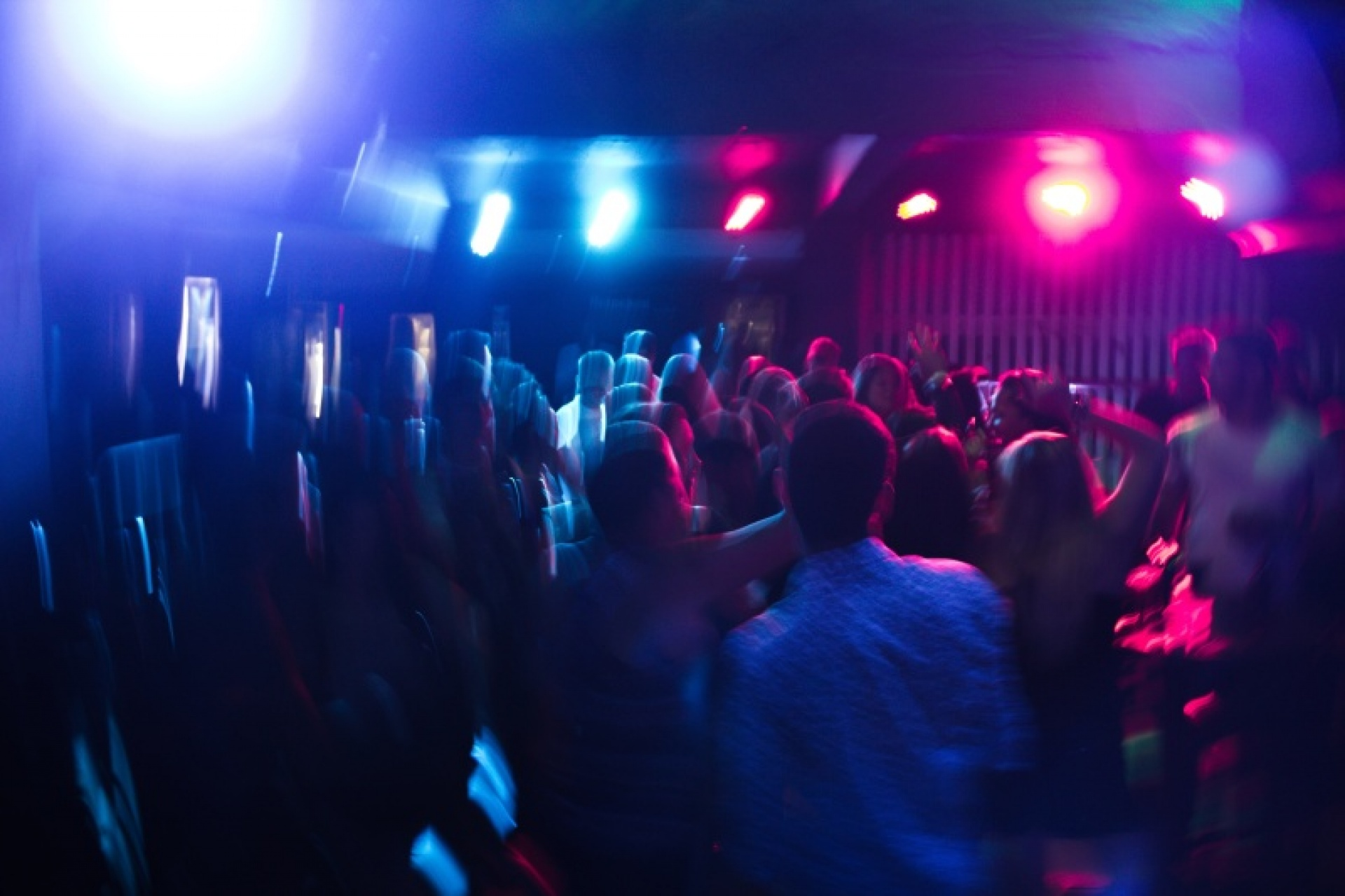 people dancing at a party in a club