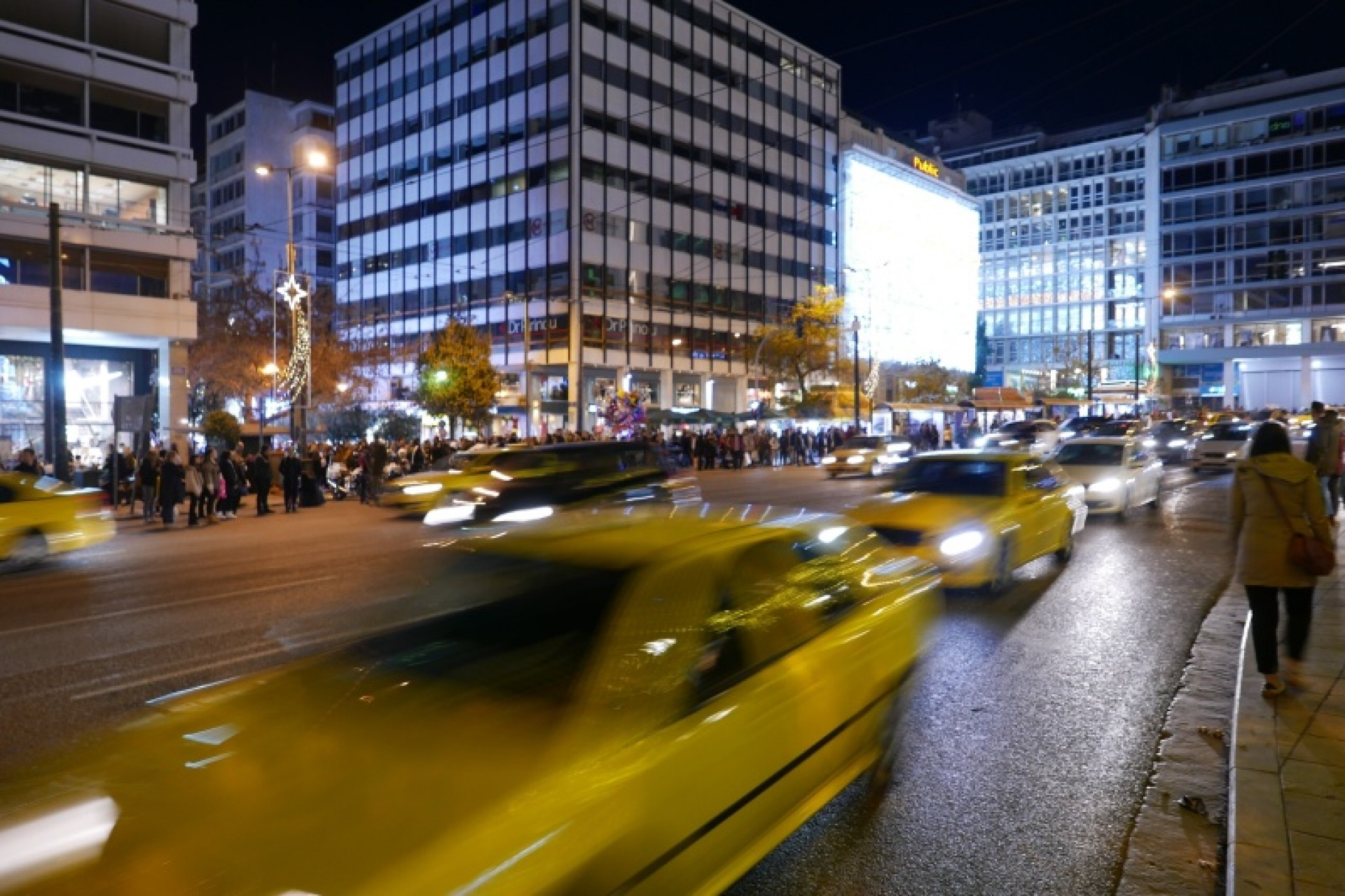 Busy Athens street at night